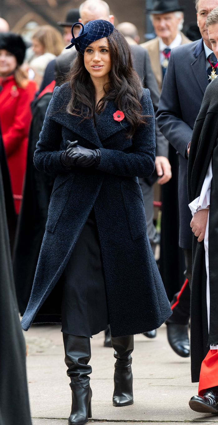 Meghan Markle wearing knee high boots: