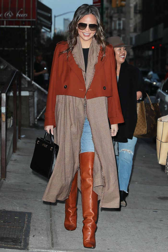 Chrissy Teigen skinny jeans and boots