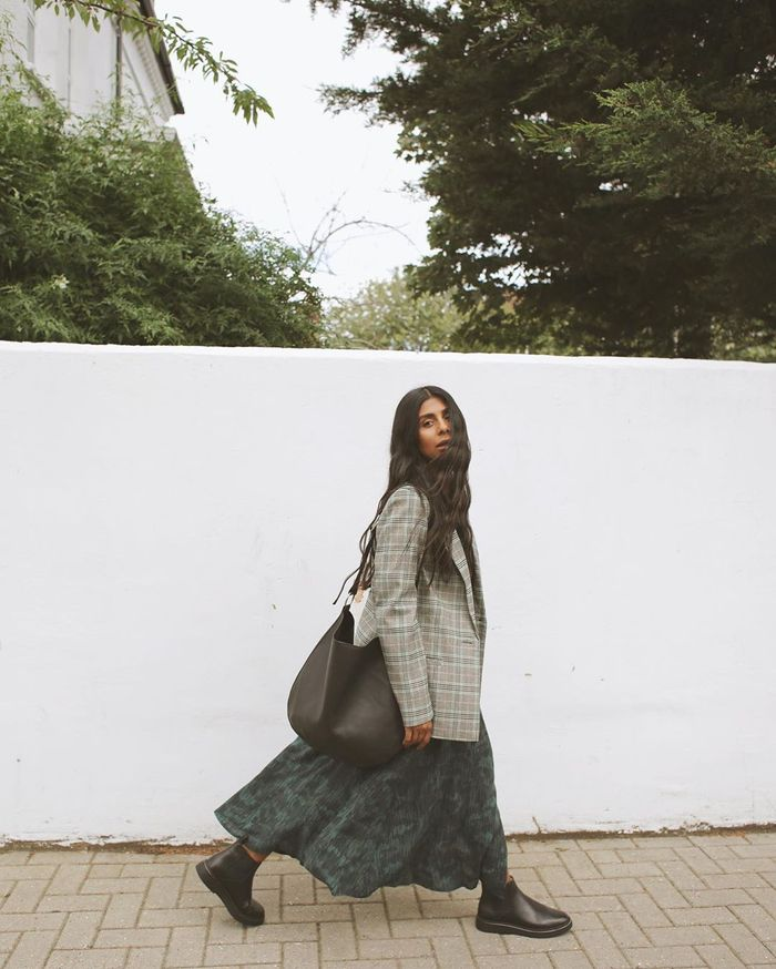 Affordable Winter Outfits: Monikh wears a checked blazer and a printed midi dress