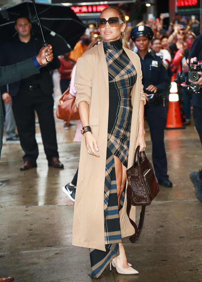 Jennifer Lopez outfit in a trench coat and heels