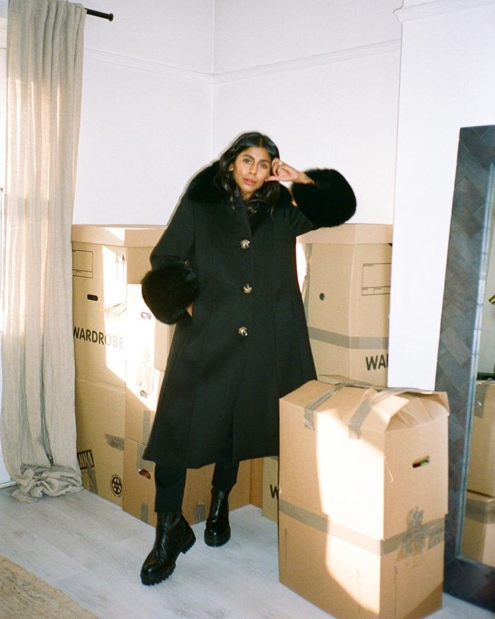 Best Black Wool Coats: @monikh wears a black wool coat from Saks Potts