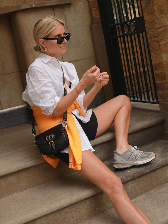 Best designer handbags 2020: lucy williams wearing a Dior handbag in cycling shorts and a white shirt