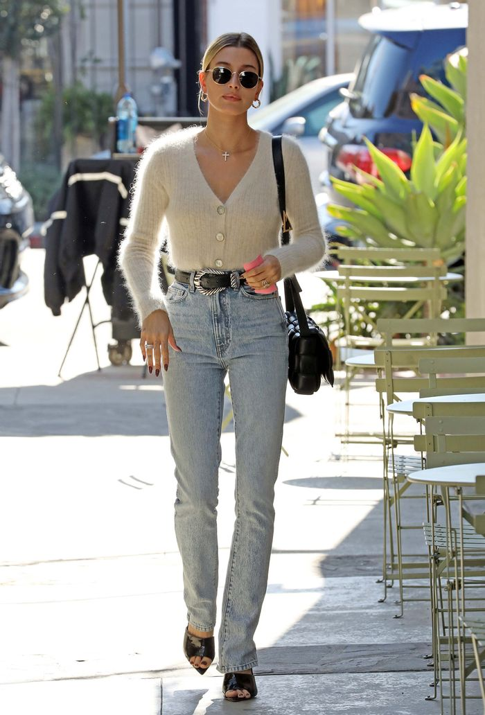 Cardigan tucked into jeans: Hailey Bieber