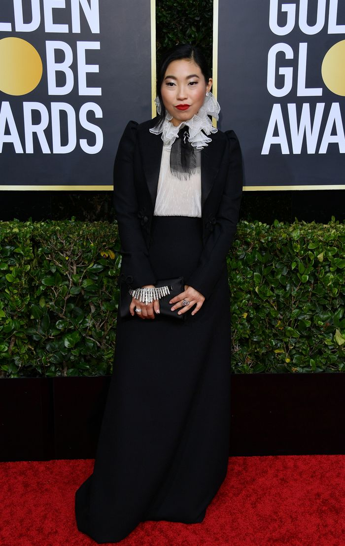 Awkwafina Style: Awkwafina's classic Dior dress is made even more high-end with the addition of a cropped tuxedo jacket.