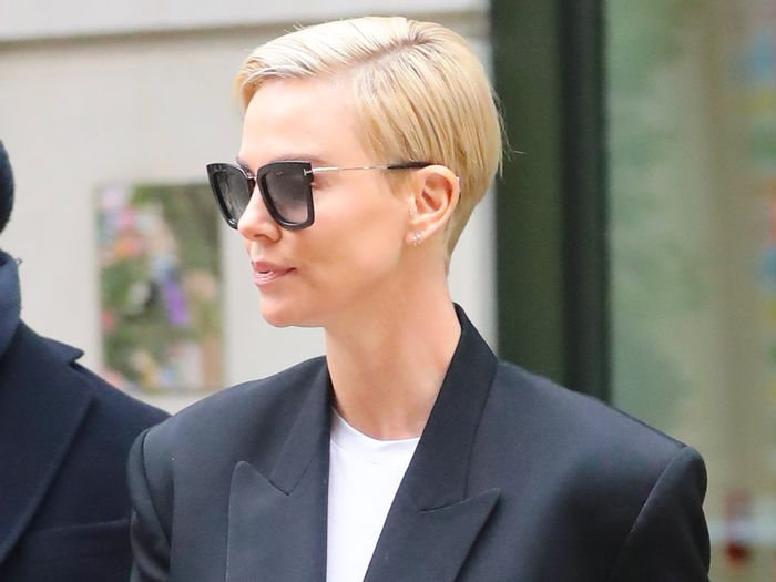 Charlize Theron Wore Skinny Jeans With $80 Adidas Sneakers