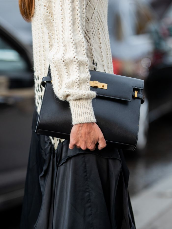 hermes watches: street style star wearing an hermes bag
