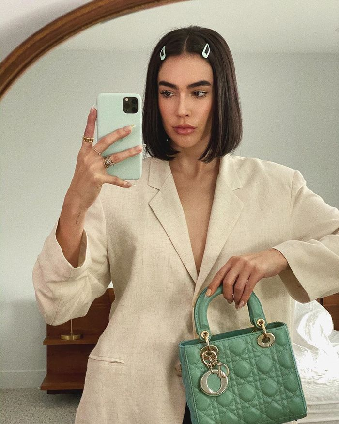 Spring 2020 Capsule Wardrobe: @brittanyxavier wears a linen suit and sage accessories