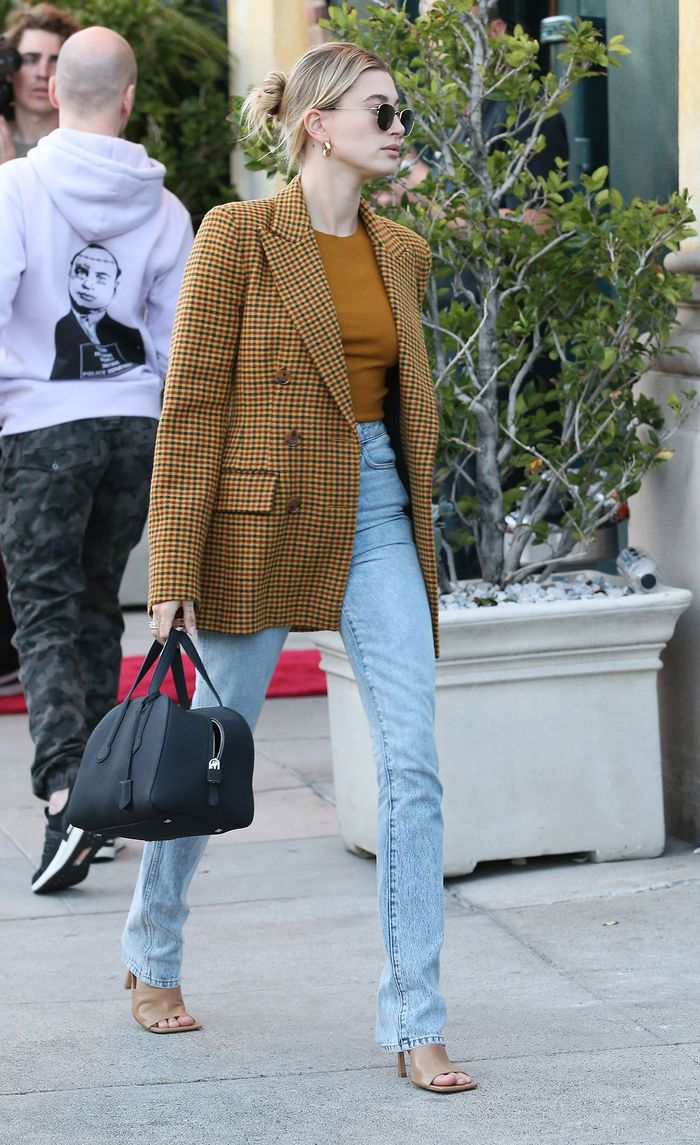 Hailey Bieber wearing a blazer and jeans