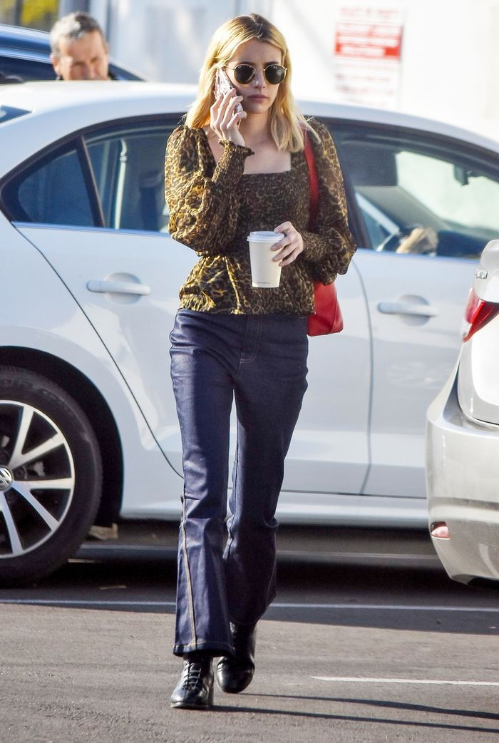 Emma Roberts Wears a Leopard-Print Blouse With Jeans