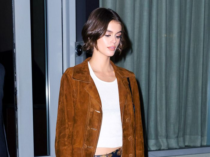 Kaia Gerber Wore Low-Rise Flare Leggings With Ankle Boots for a Night Out