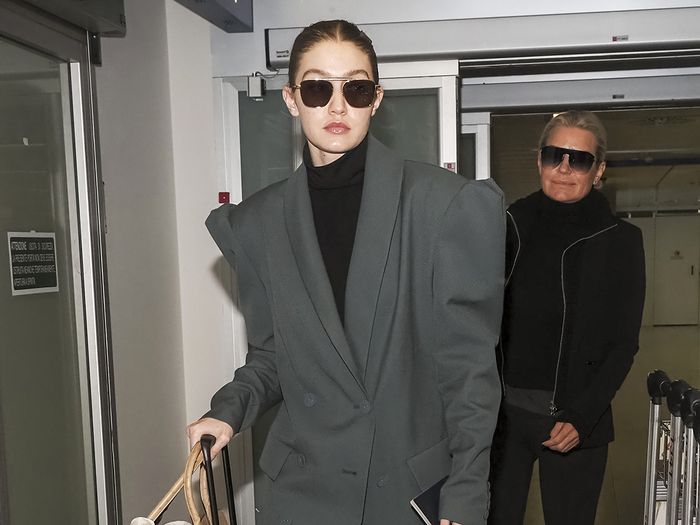 Gigi Hadid Wore Spring's Biggest Legging Trend to the Airport in Italy
