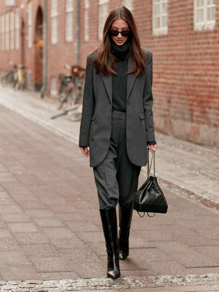 knee-high boots tucked in trousers: street style