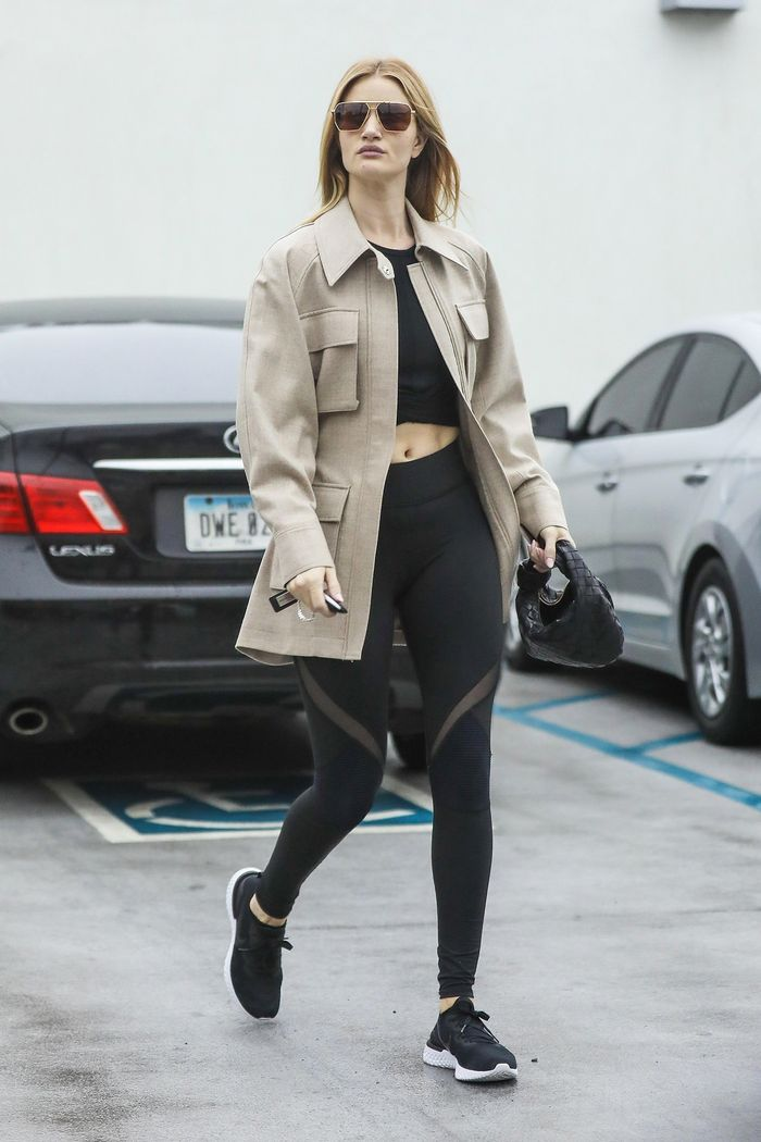 Rosie Huntington-Whiteley wearing leggings and a utility jacket