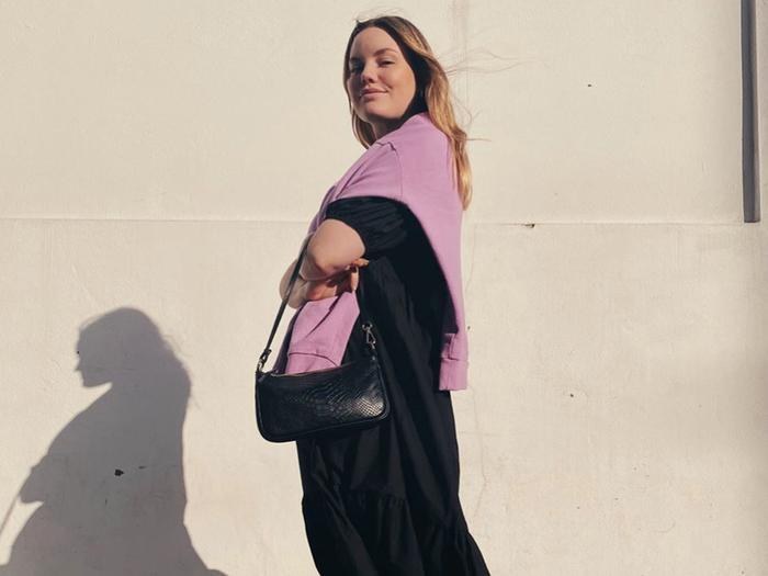 Black Dress Pink Sweater Baguette Bag
