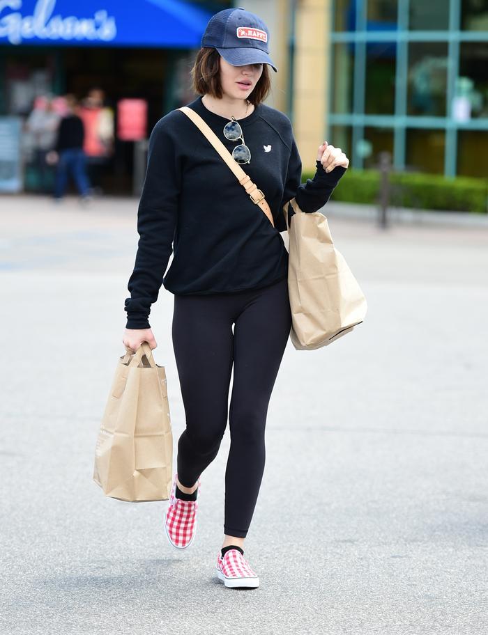 Lucy Hale Wore Slip-On Vans Checkerboard Sneakers