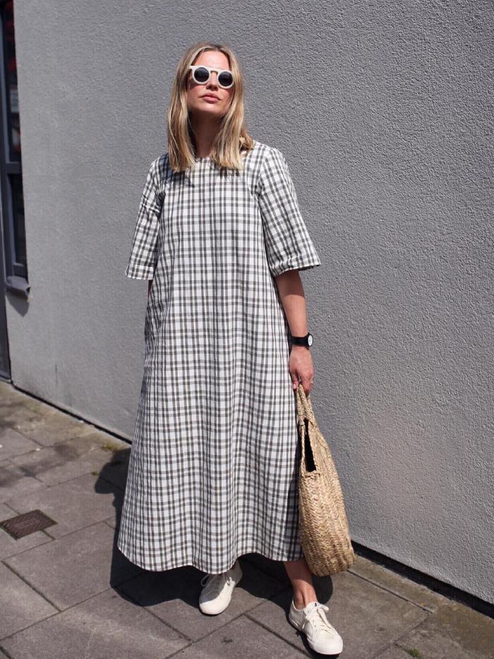 best t-shirt dresses: alexis foreman wearing a t-shirt dress