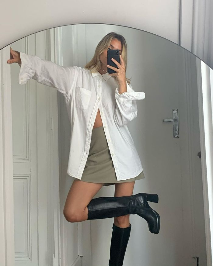How to wear a white button-down shirt with a mini skirt