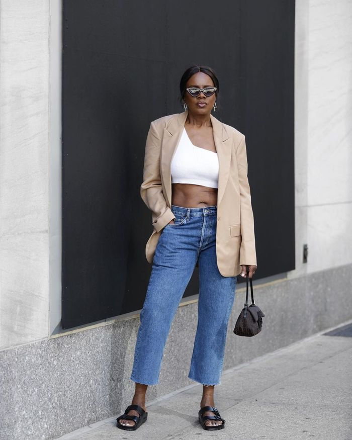 The easy items a 56-year-old New Yorker wears: crop top and jeans