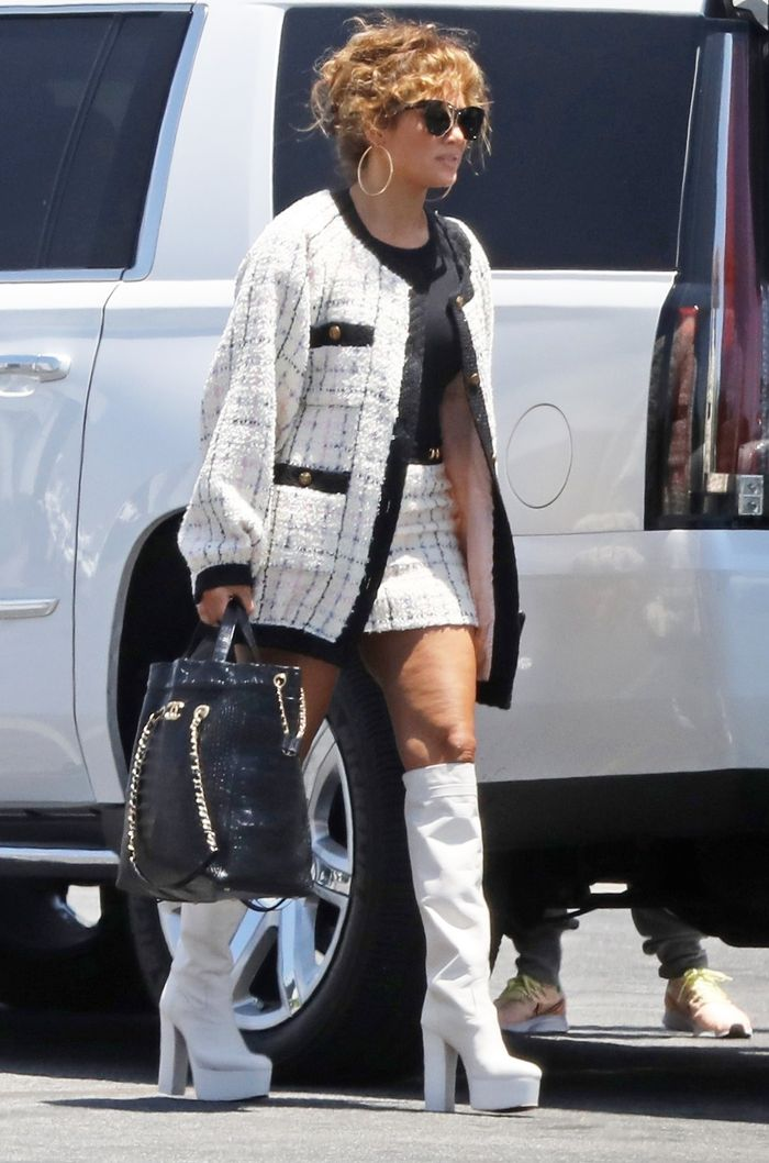 Jennifer Lopez Wears a Gucci Mini Skirt With White Boots