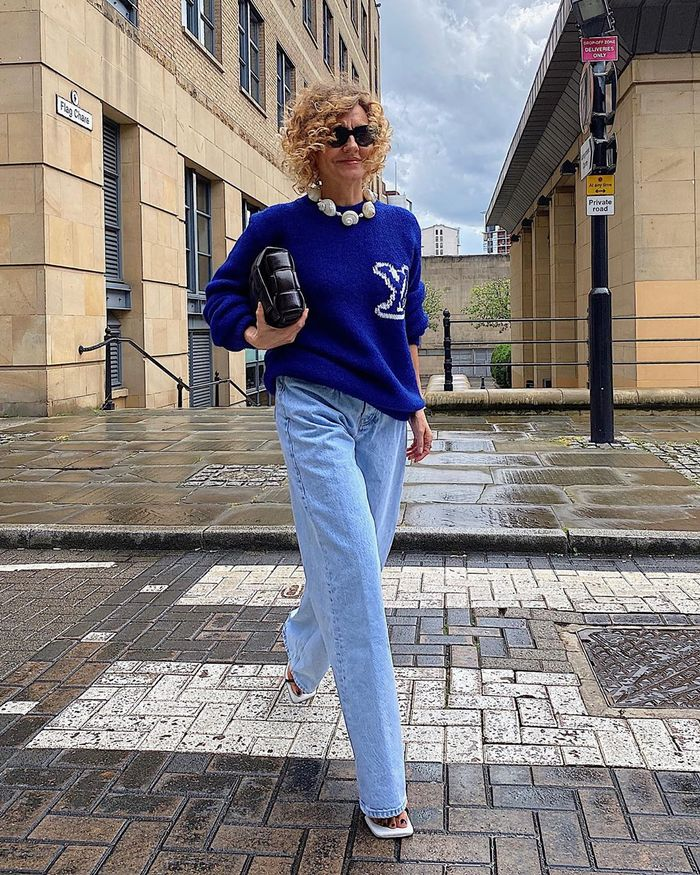 The best loose-fitting jeans with a Louis Vuitton sweater