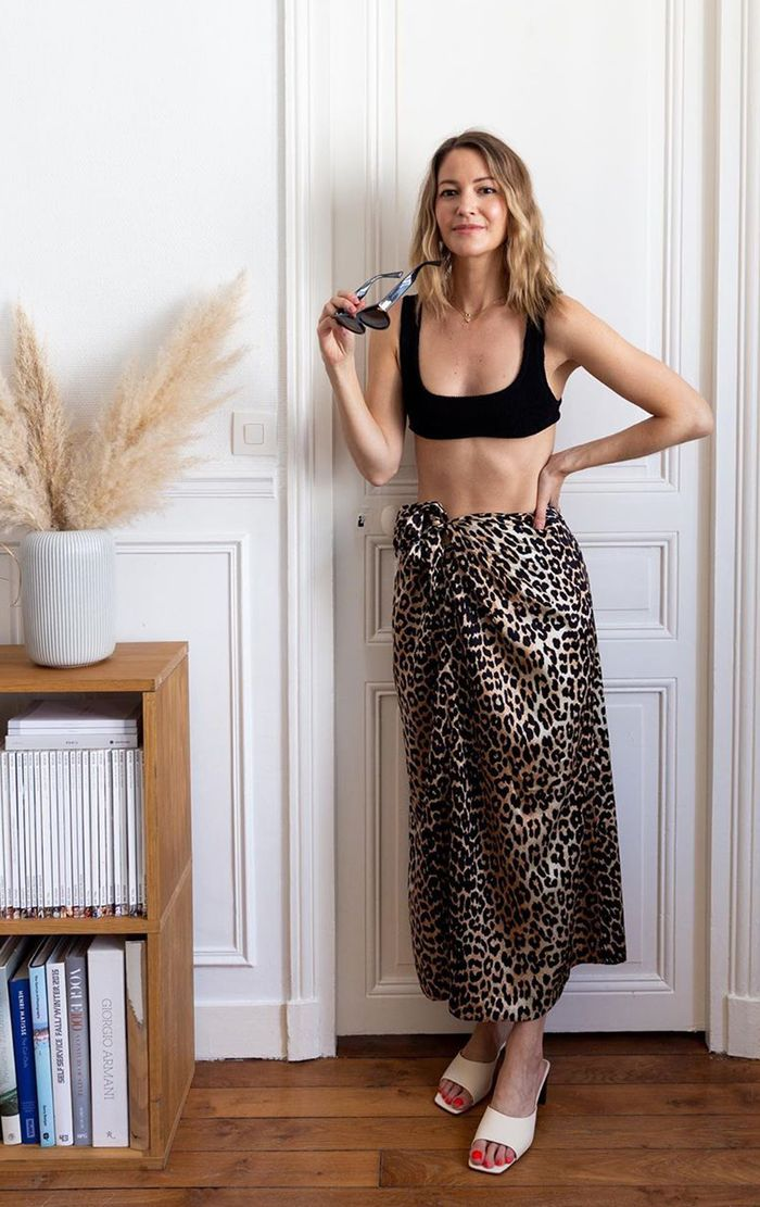 French swimwear: Marissa Cox in black bikini and leopard print skirt