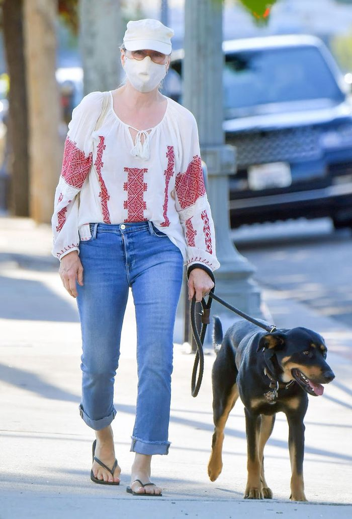 Meryl Streep Wearing Jeans and Flip Flips Walking Her Dog
