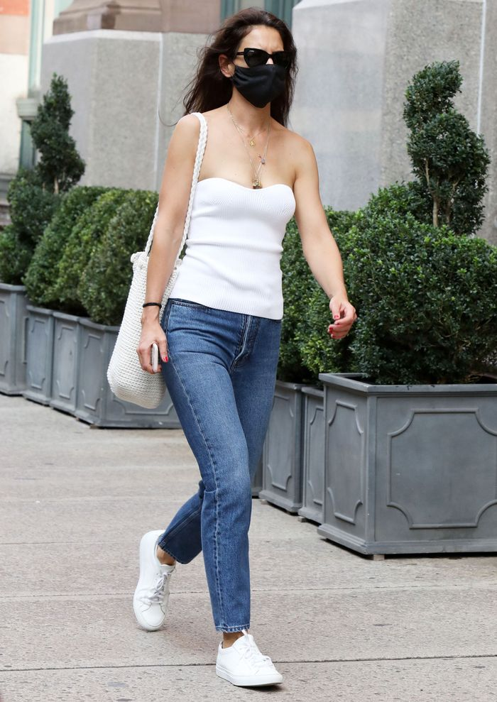 Katie Holmes wearing a tube top and skinny jeans with white sneakers