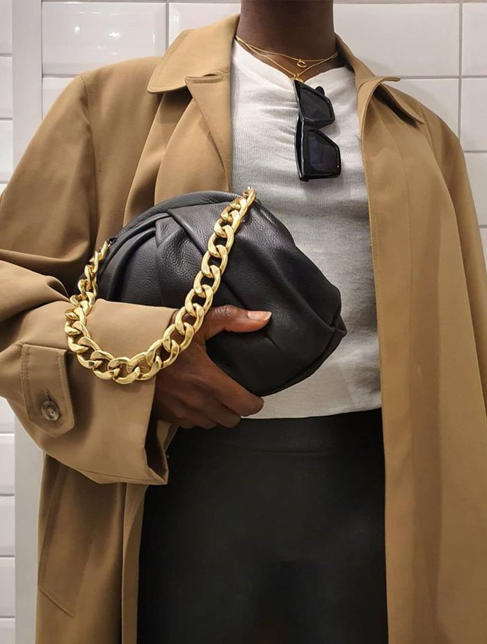 Quiet luxury buys: chain bag and trench coat