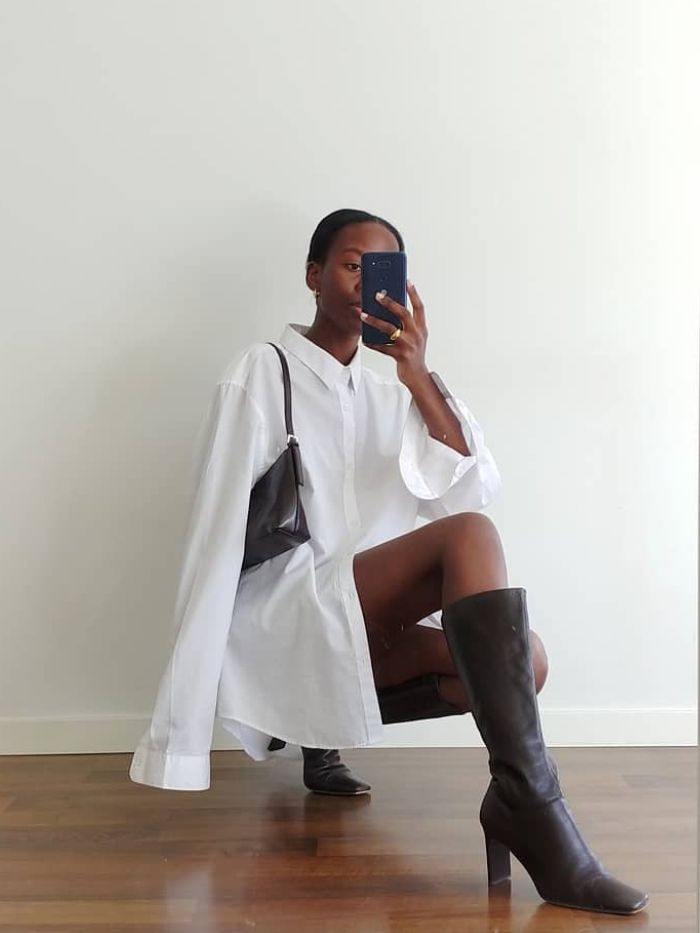 best oversized shirts: sylvie mus wearing a white oversized shirt