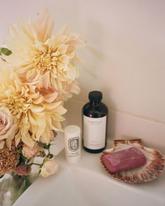 Luxury Soap: @emmahoareau creates a pretty sink space with flowers and luxury soap