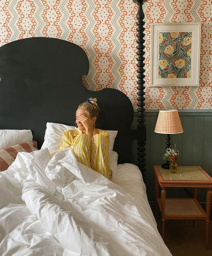 Sleep Routine Tips: Yellow pyjamas in beautiful green and wallpapered bedroom