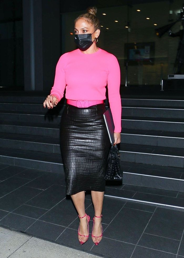 Jennifer Lopez wearing a croc leather pencil skirt