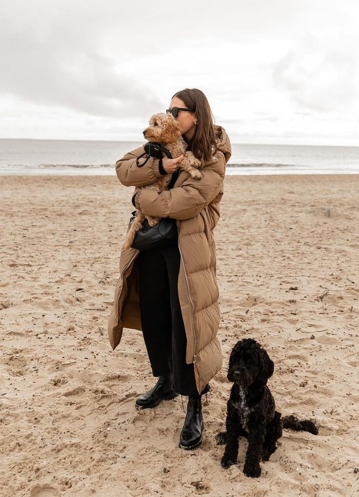 Arket puffer coat: Jessica Skye wearing Arket's long down puffer coat in beige