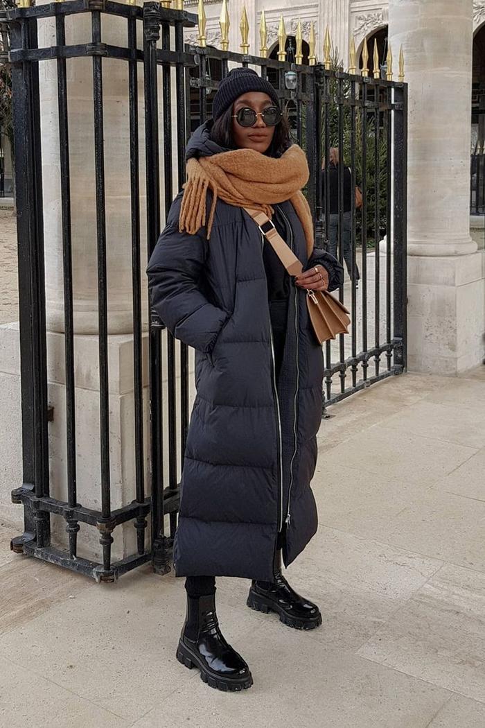 Arket puffer coat: Erica Davies wearing Arket's long down puffa coat in beige
