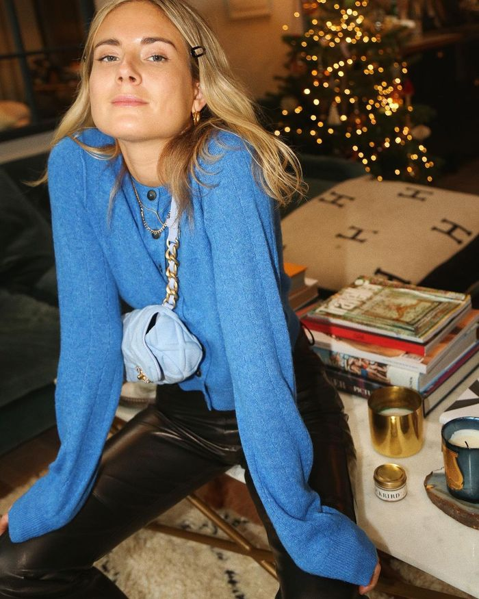 Luxury Christmas Gifts for Her: Lucy Williams wears a blue cardigan and matching bag