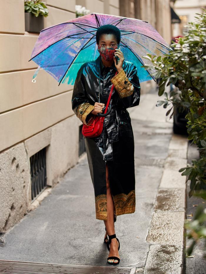 where to buy face masks: tamu mcpherson wearing a mask during milan fashion week