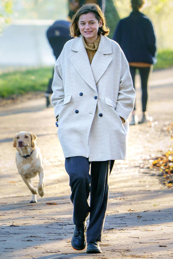 Emma Corrin Style: Mango Coat + Grey Trousers