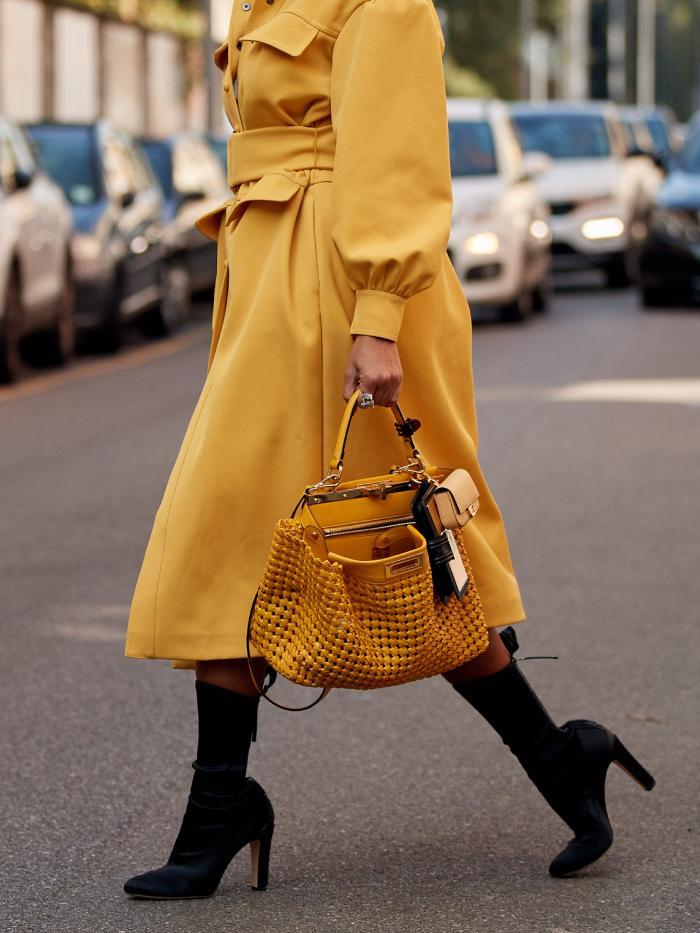 Boot trends 2021: street styler wearing black boots