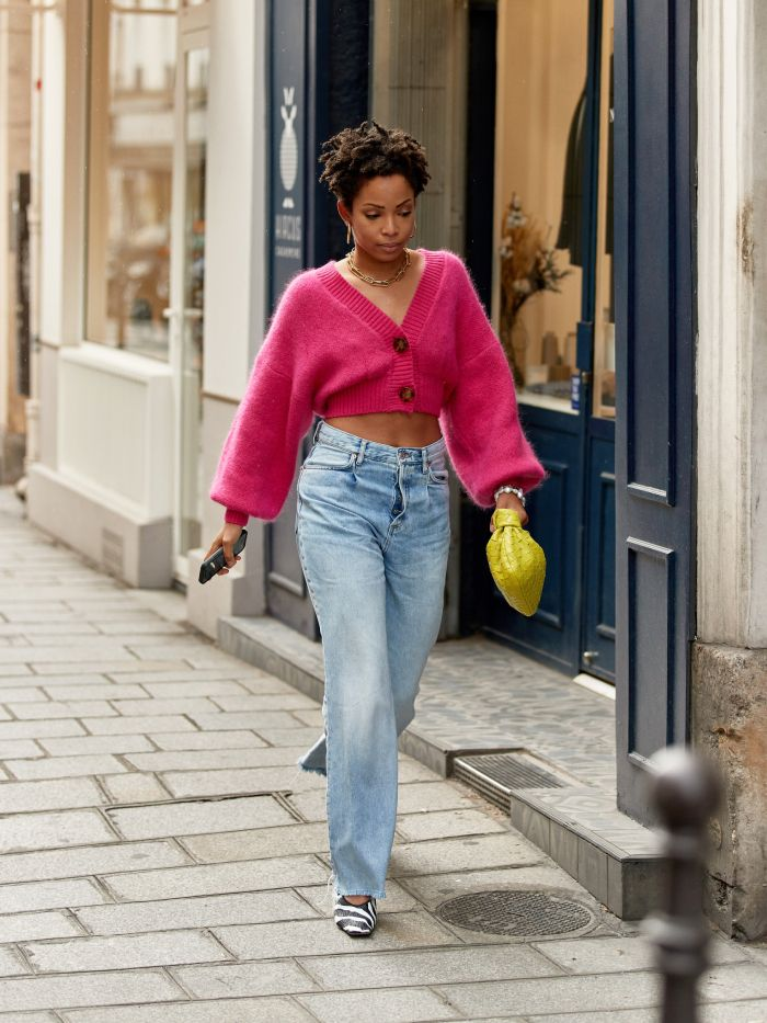 wishlisting buyers 2021 trends: ellie delphine wearing a hot pink cardigan and pair of blue jeans
