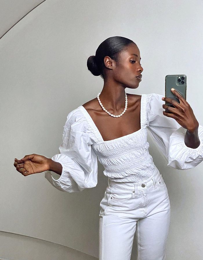 tops trends 2021: white puff sleeves ruched top with white jeans