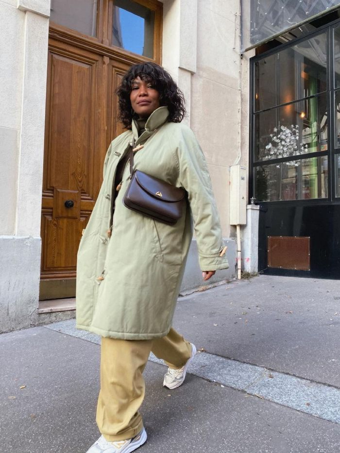 pastel colour trend: franny fyne in pistachio coat and pale yellow trousers