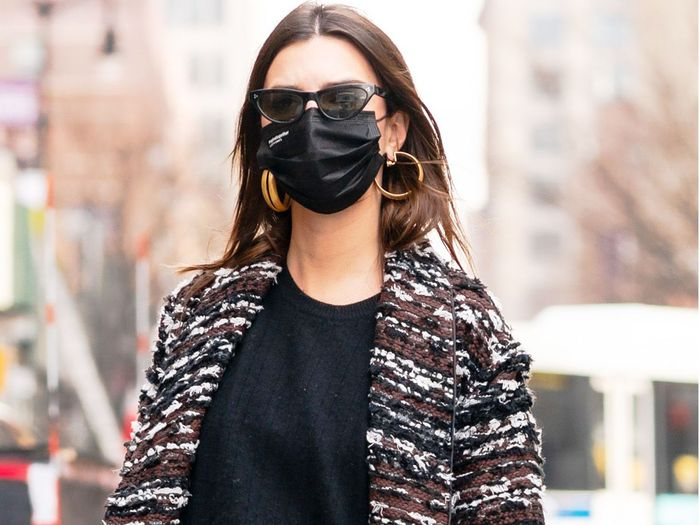 Emily Ratajkowski Wore Leggings With Snake-Print Boots Like a Boss