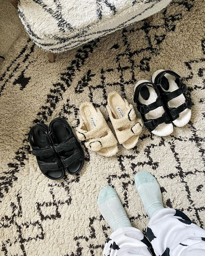 Shearling Sandals: @erica_davies displays her shearling sandal collection