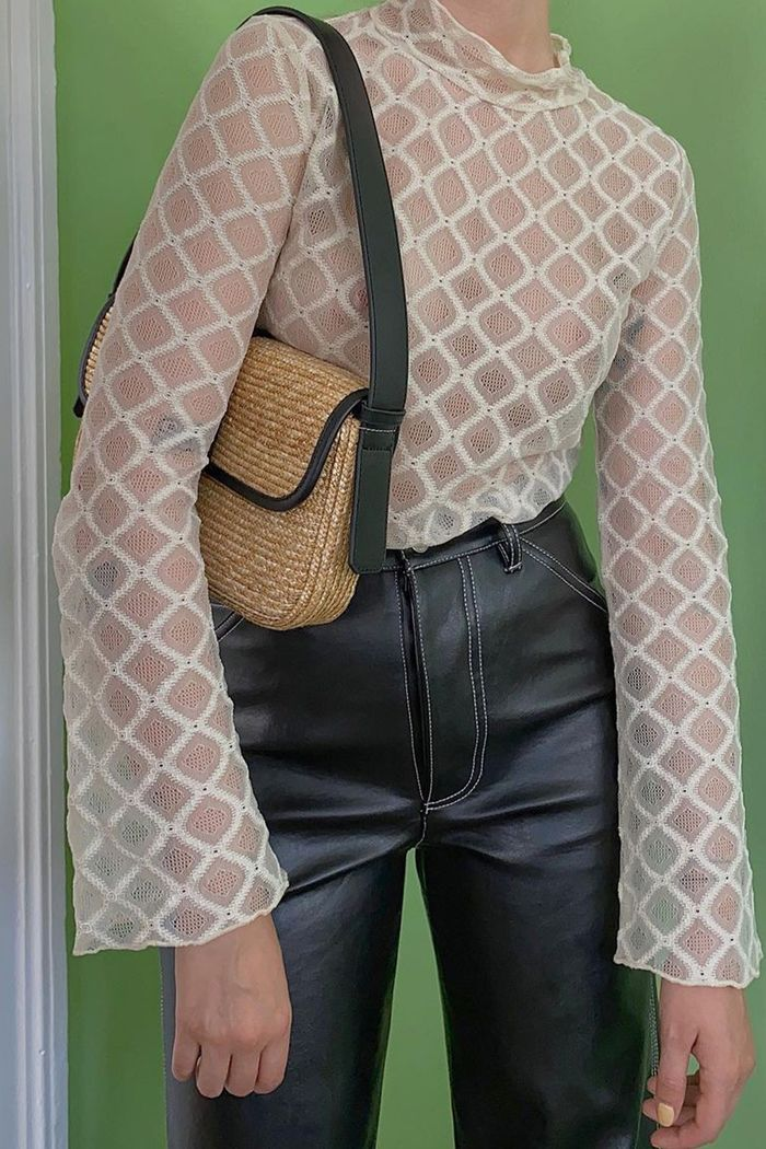 see through clothes trend 2021: sheer blouse with leather trousers