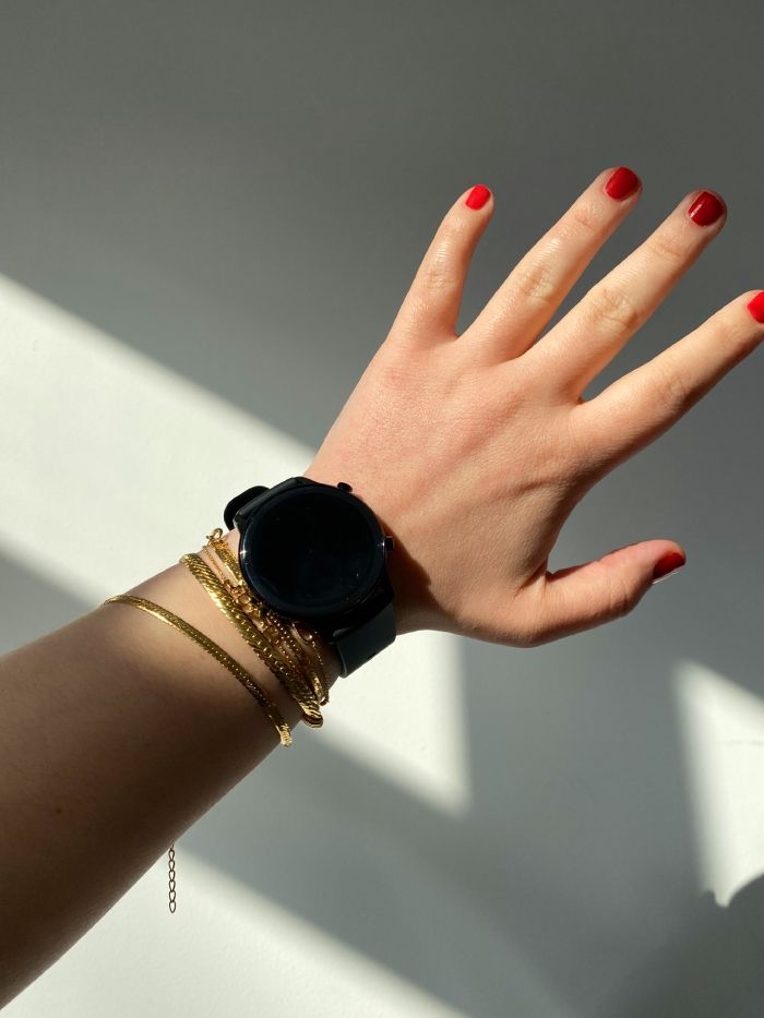 best smartwatches for women: elinor wears the honor watch with gold bracelets
