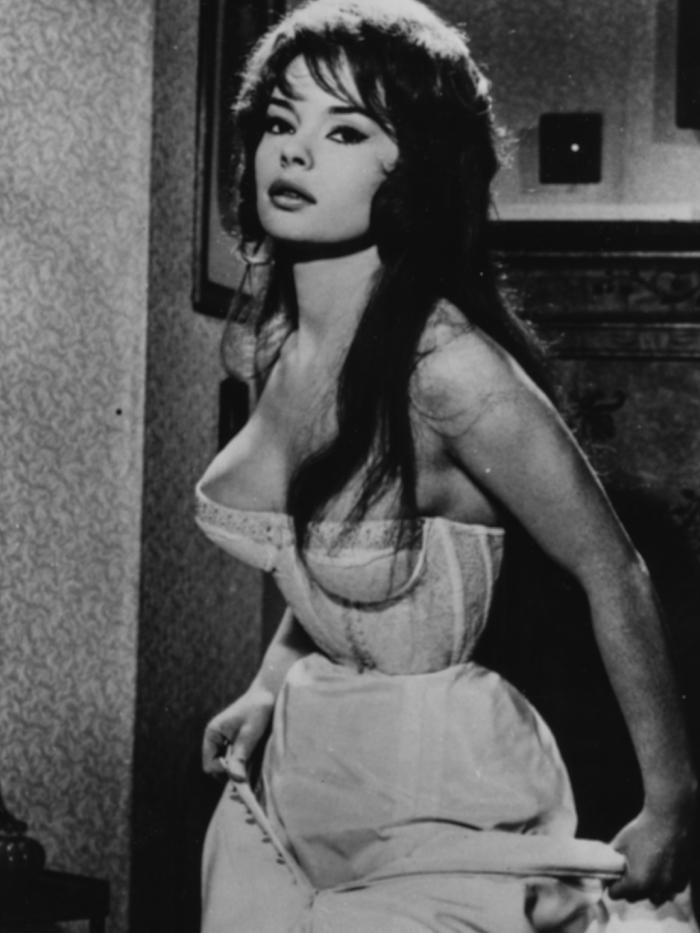corset trend: French actress Pascale Petit wearing a corset, circa 1960
