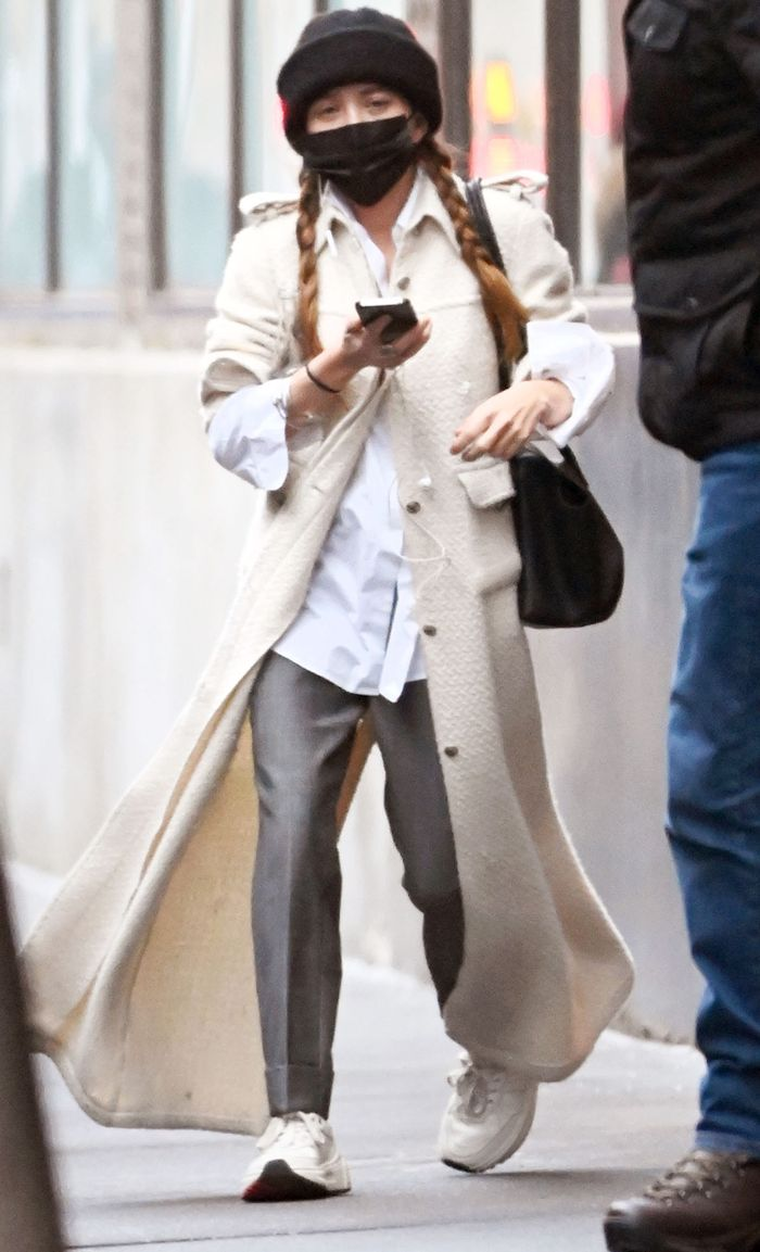 Mary-Kate Olsen wearing pants and sneakers instead of jeans
