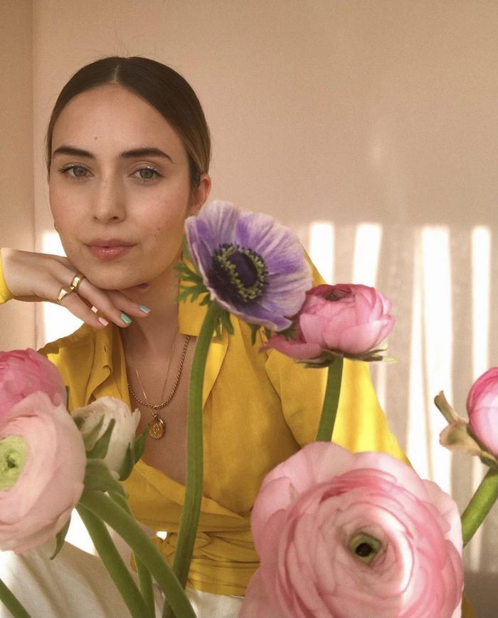 Best New Perfumes: Elif wearing yellow shirt surrounded by flowers