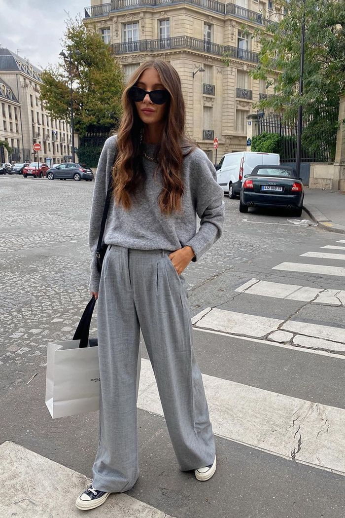 spring outfits 2021: grey jumper with wide-leg trousers