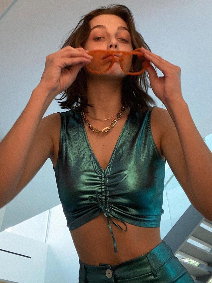 Emma Chamberlain Beauty Favourites: Emma wearing sunglasses and metallic top